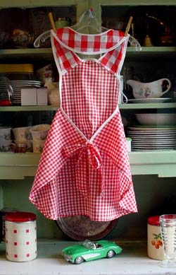 Back of 1940 child apron in red gingham