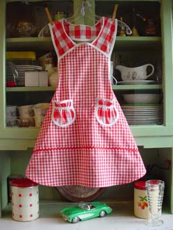 Front of 1940 child apron in red gingham